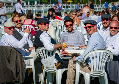 group enjoying horse racing