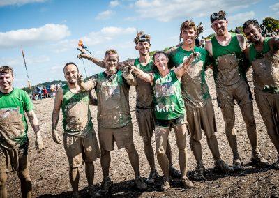 team photo on Tough Mudder