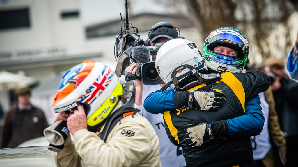 racing drivers celebrate after race