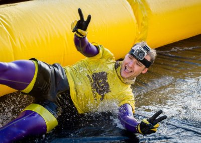 runner water sliding on charity run