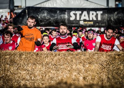 runners go over straw bales