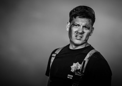 firefighter with dirty face portrait photo