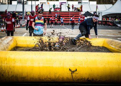 runner falls in mud pool charity run