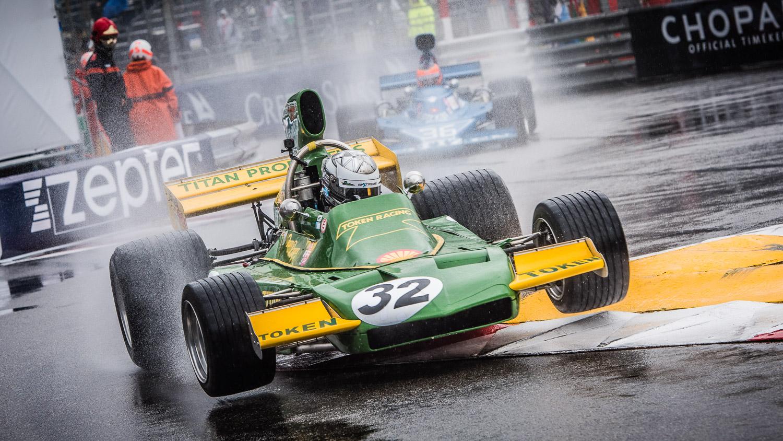 Classic F1 car jump kerb in rain