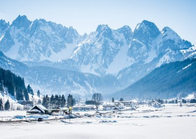 snow capped mountains behind village