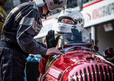 racing driver talks to marshall