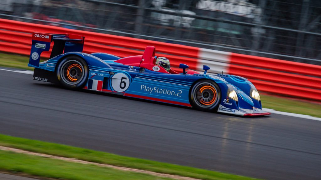 LMP2 race car with glowing brakes