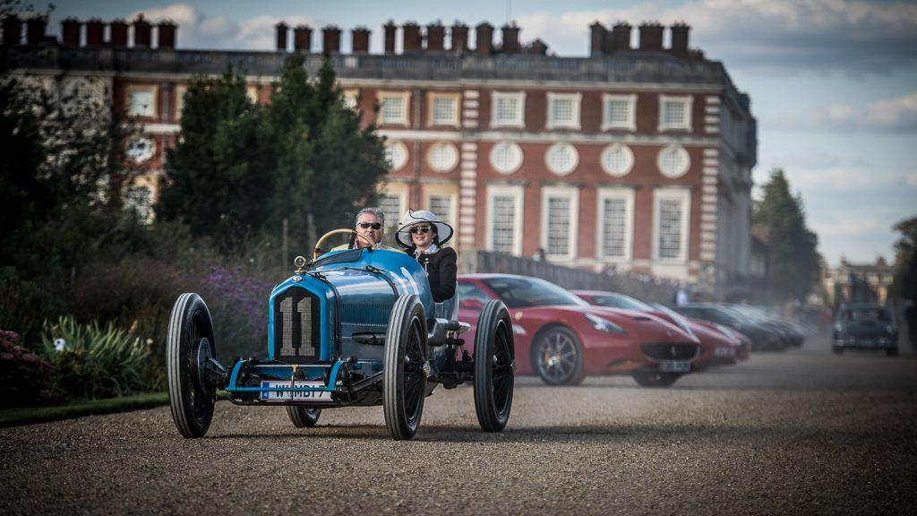Big hat Lady passenger blue classic car