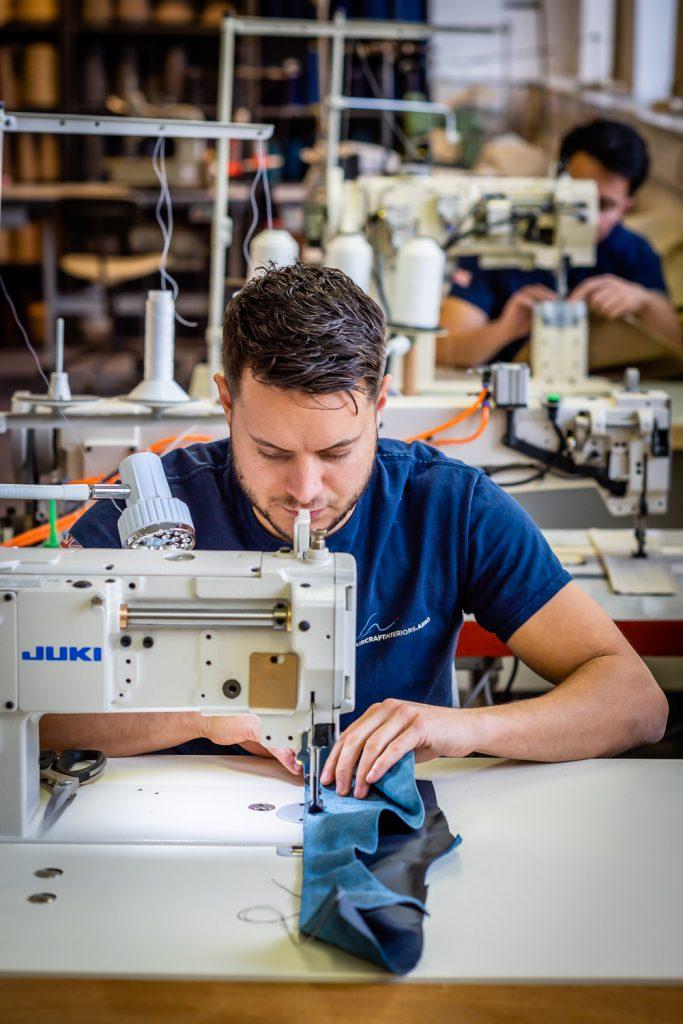 Craftsmen machining leather
