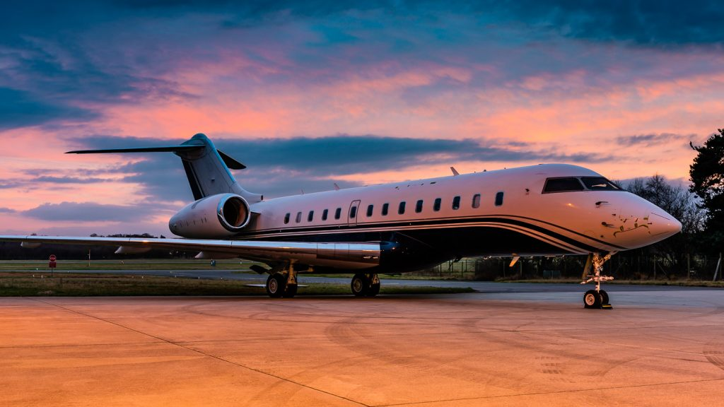 private jet at sunset