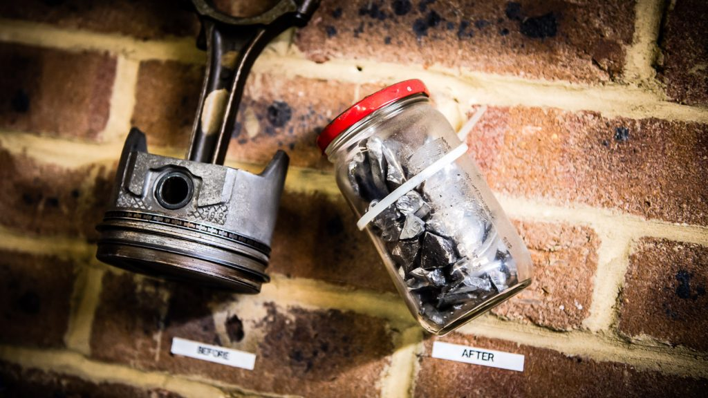 broken pieces of piston in jar
