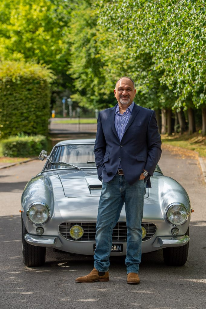 Man and silver Ferrari GT Berlinetta