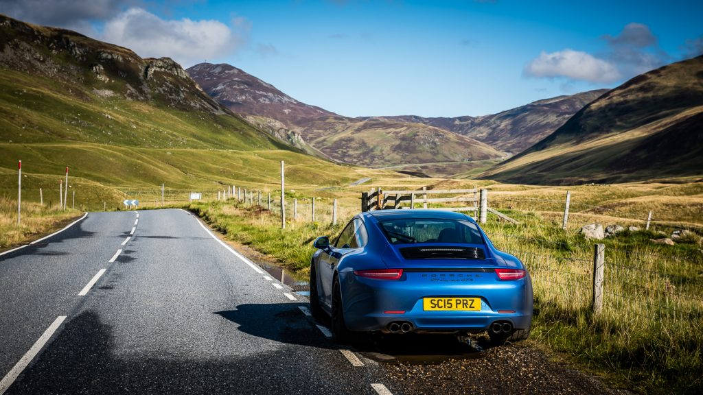 blue Porsche in Cairngorms
