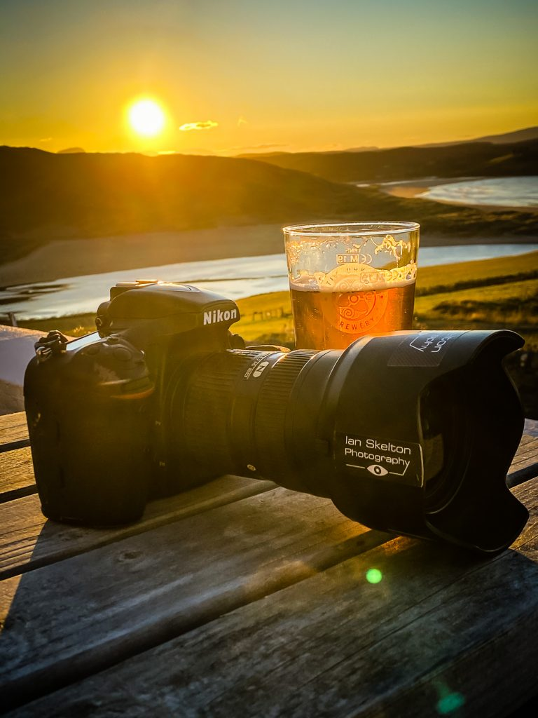 Camera beer and sunset