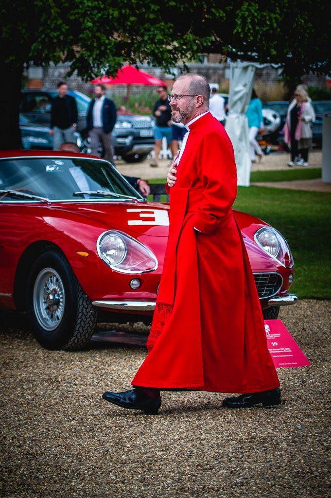 priest walking car show