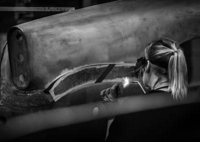 girl gas welding car panel