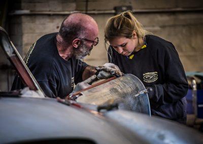 engineers man and girl work on car