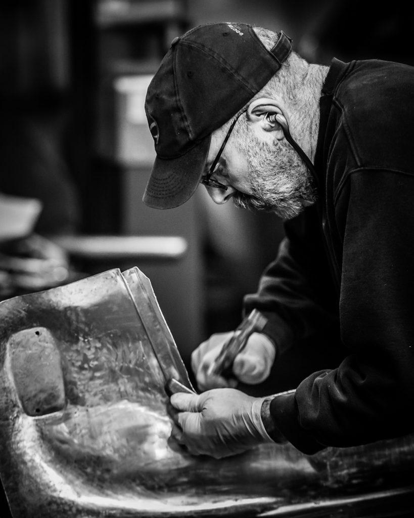 Traditional panel beating craftsmanship