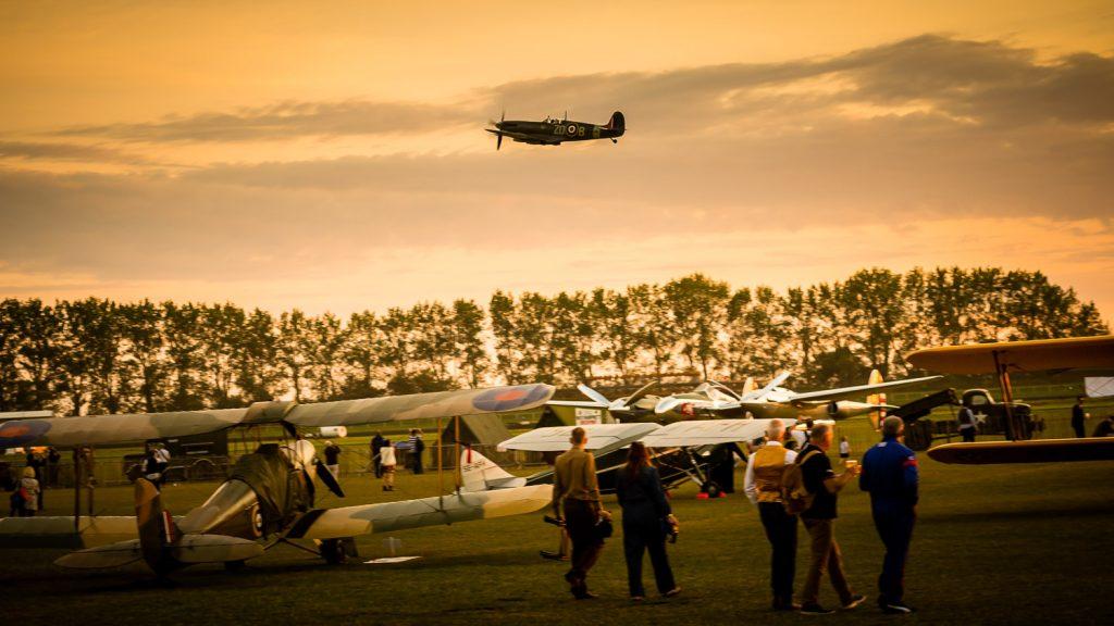 Spitfire climbs at sunset